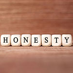 Word HONESTY made with wood building blocks