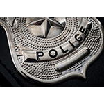 """Cops and police officer badge with macro close up on the """"police"""
